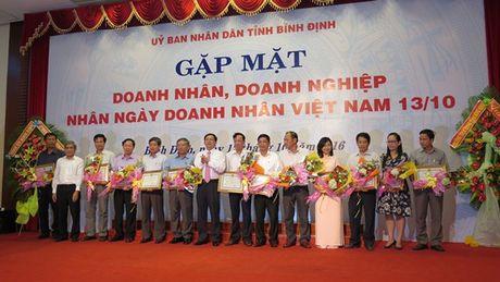 Chu tich Binh Dinh Ho Quoc Dung: 'Doanh nghiep Binh Dinh se tham gia hoach dinh chinh sach phat trien kinh te dia phuong' - Anh 2
