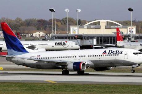 Chi phi gia tang, loi nhuan quy III/2016 cua Delta Air Lines xuong thap - Anh 1