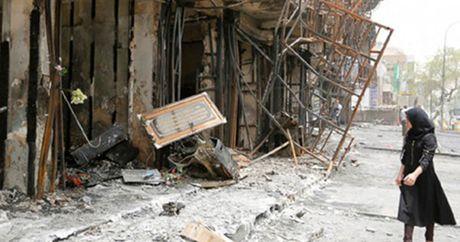 IS thua nhan danh bom lieu chet o thu do Baghdad cua Iraq - Anh 1
