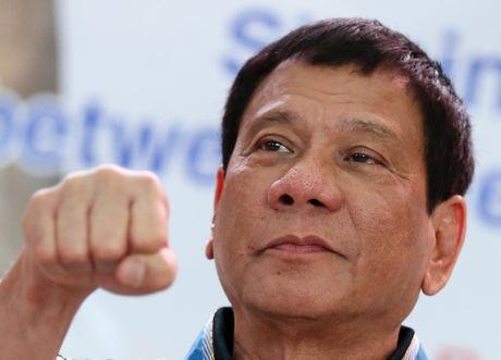 Tong thong Philippines dong y bi luan toi neu tu bo chu quyen cho Trung Quoc - Anh 1