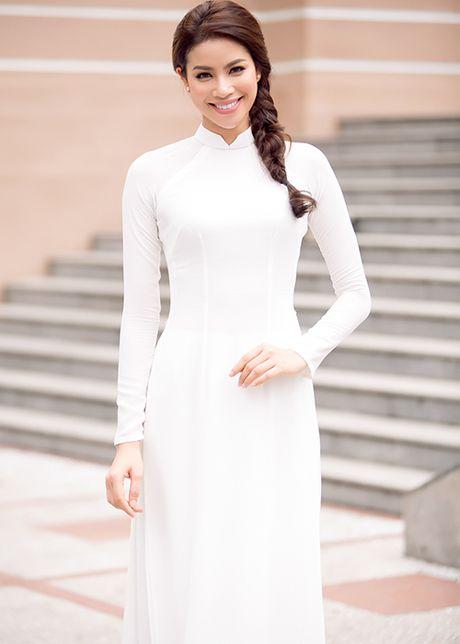 HH Pham Huong dep hut hon voi ao dai trang tinh khoi - Anh 8