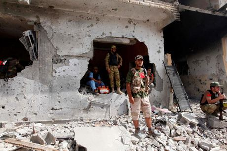 Libya danh duoi phien quan IS cuoi cung khoi thanh pho Sirte - Anh 12