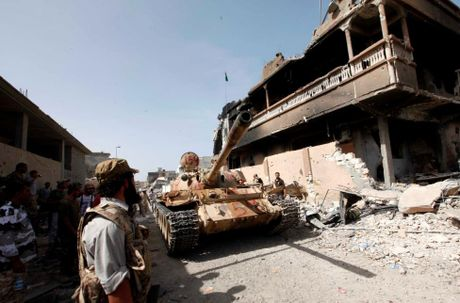 Libya danh duoi phien quan IS cuoi cung khoi thanh pho Sirte - Anh 1