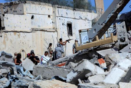 Libya danh duoi phien quan IS cuoi cung khoi thanh pho Sirte - Anh 5