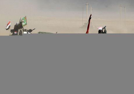 Tinh hinh giai phong Mosul: Thu linh IS thao chay sang Syria - Anh 1