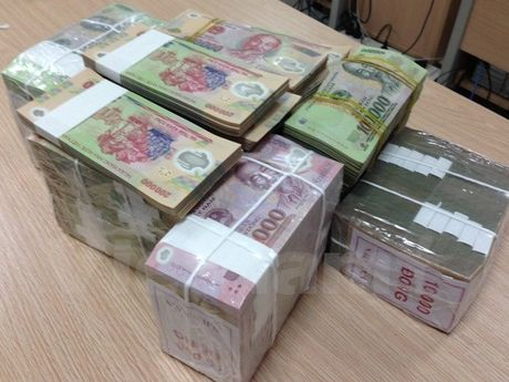 Bat giu doi tuong gia danh nha su lua dao gan 600 trieu dong - Anh 1