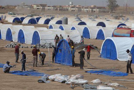 Thuong dan Iraq lu luot chay khoi thanh pho Mosul - Anh 9
