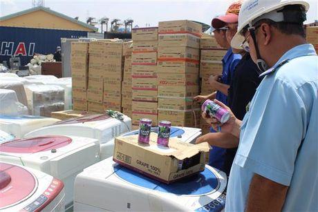Tich thu 125 container hang cam nhap khau - Anh 1
