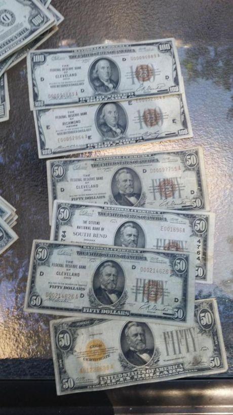 Phat hien vali chua 23.000 USD khi don nha - Anh 7