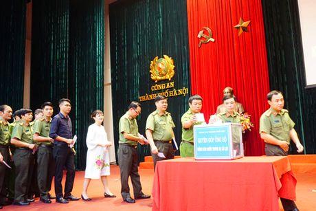 Cong an Ha Noi se chia voi dong bao gap thien tai mien Trung - Anh 2