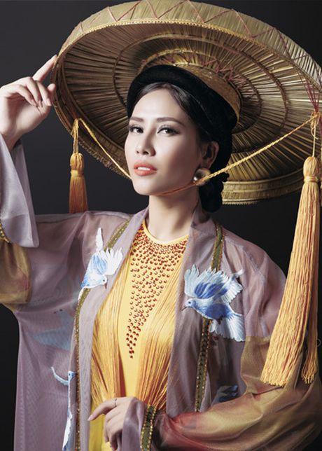Nguyen Thi Loan lot top 3 trang phuc dan toc dep nhat Hoa hau Hoa binh Quoc te 2016 - Anh 4