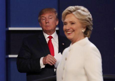 Tranh luan cuoi cung: Ong Trump va ba Clinton nong vi Tong thong Putin - Anh 1