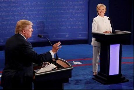 Clinton cao buoc Nga tan cong mang My, Trump noi Clinton la con roi - Anh 1