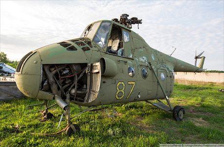 Ngac nhien: Nga hoi sinh truc thang Mi-4 tu 'nghia dia' - Anh 4