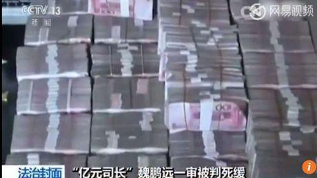 Truyen hinh TQ phat canh thu giu 2,3 tan tien tham nhung - Anh 1