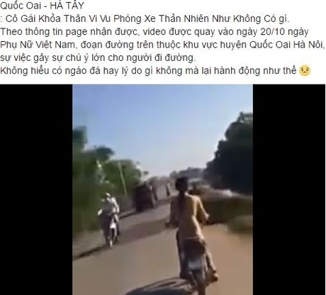 Co gai khoa than di xe may giua duong pho Ha Noi - Anh 1