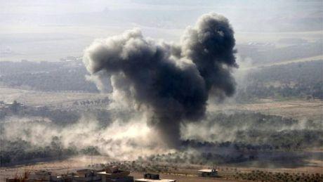 Luc luong IS tan cong thi tran phia Tay Iraq de phan tan hoa luc tai Mosul - Anh 1