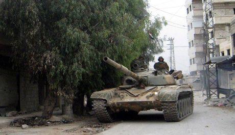 Quan doi Syria dap tan tuyen phong thu phien quan o ngoai vi Damascus - Anh 1