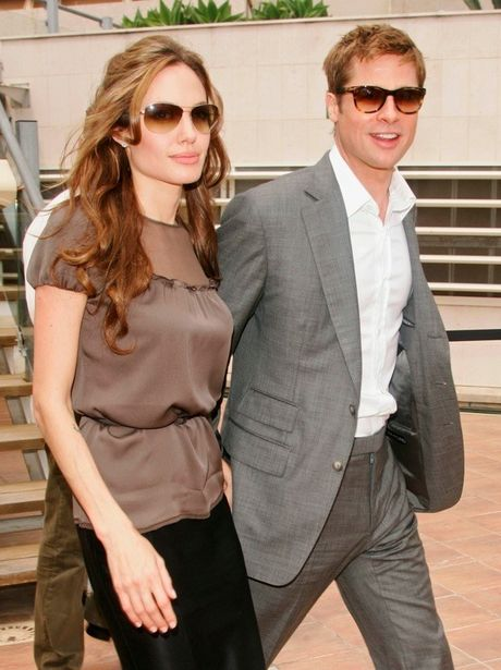 Angelina se tiet lo chuyen phong the 3 nguoi cung Brad Pitt? - Anh 1