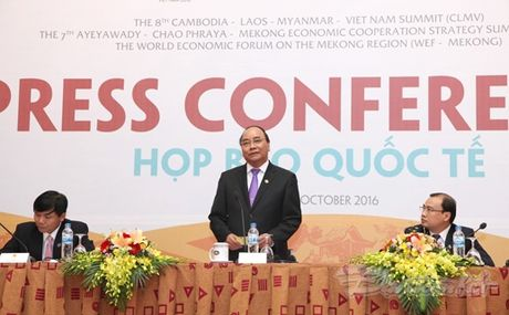 Thu tuong: Viet Nam nang cao moi truong dau tu de vuon len top dau ASEAN - Anh 2