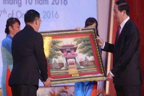 Chu tich nuoc Tran Dai Quang du le ky niem 40 nam Truong Dai hoc Kinh te TP Ho Chi Minh - Anh 2