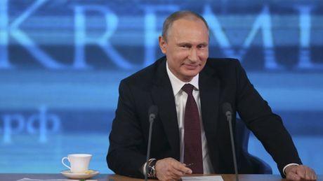 Tong thong Putin dat tin nhiem cao ky luc nam 2016 - Anh 1