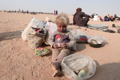 Am anh nhung anh mat tre ti nan Iraq chay tron bao luc o Mosul - Anh 14