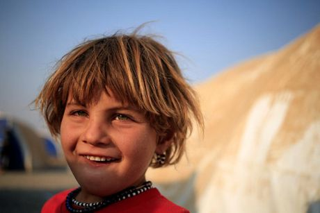 Am anh nhung anh mat tre ti nan Iraq chay tron bao luc o Mosul - Anh 3