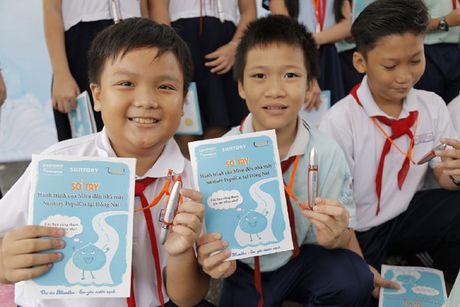 700 hoc sinh tieu hoc tham quan thuc te nha may Suntory PepsiCo Viet Nam - Anh 3