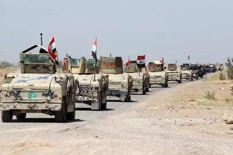Quan doi Iraq tien cong, IS bi bao vay va co cum tai Mosul - Anh 1