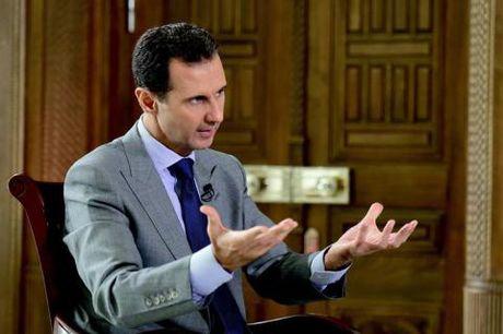Tong thong Syria tra loi bao My:Toi se cam quyen toi 2021 - Anh 1