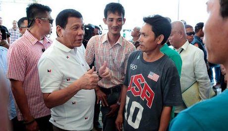 VN hoan nghenh Philippines giai quyet nhan dao van de ngu dan - Anh 1