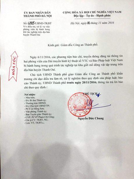 Chu tich TP Ha Noi Nguyen Duc Chung chi dao lam ro viec danh phong vien - Anh 2