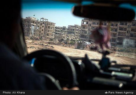 Cuoc song trong 'mua bom bao dan' cua cu dan Aleppo - Anh 1