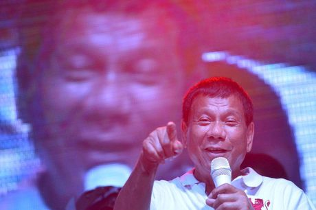 Ly do ong Duterte ngoi ca ong Putin la than tuong - Anh 1