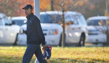 Tong thong Obama lam gi trong ngay tong tuyen cu? - Anh 1