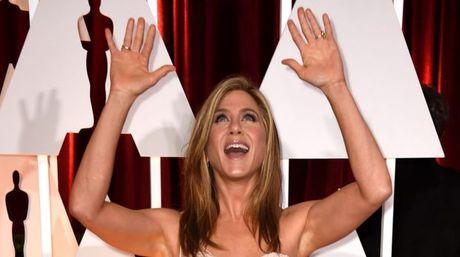 Jennifer Aniston buc xuc vi bi chi trich khong co con - Anh 1