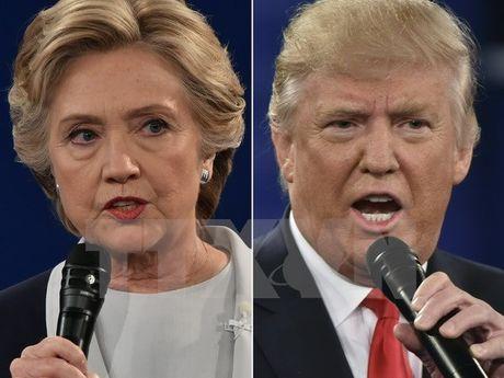 Ba Clinton dan truoc ong Trump voi ty le phieu dai cu tri 68-48 - Anh 1
