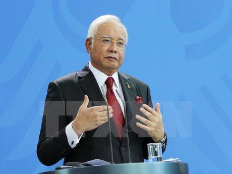 Quan chuc Malaysia so TPP do vo vi ong Trump thang cu - Anh 1