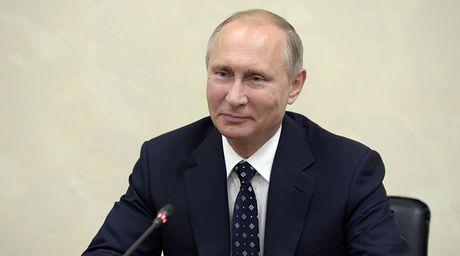 Ong Putin len tieng ve ket qua bau cu Tong thong My - Anh 1