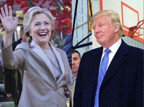 Ong Trum bi la o, ba Hillary duoc chao don khi di bau - Anh 1