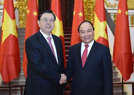 Thu tuong hoi kien Uy vien Thuong vu Bo Chinh tri Trung Quoc Truong Duc Giang - Anh 1