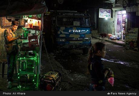 Cuoc song o khu dan cu rinh rap hiem nguy tai Aleppo - Anh 11