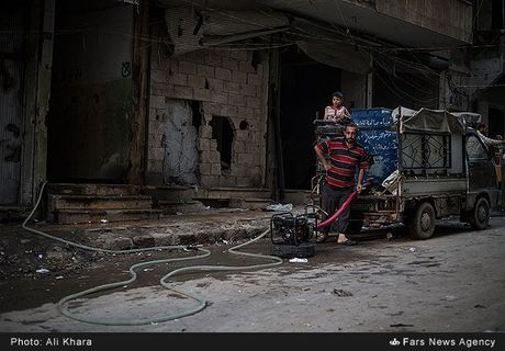 Cuoc song o khu dan cu rinh rap hiem nguy tai Aleppo - Anh 9
