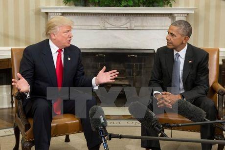 'Van ton tai khac biet sau sac' giua ong Obama va ong Trump - Anh 1