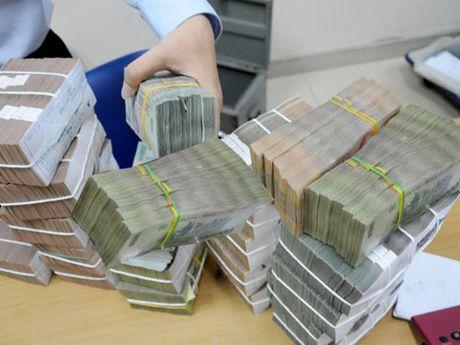 Ha Noi: 10 thang thu hoi 9.964 ty dong no thue - Anh 1
