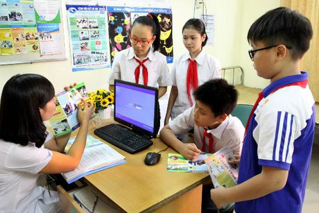 Ha Noi phan dau thu BHYT hoc sinh, sinh vien dat 100% - Anh 1