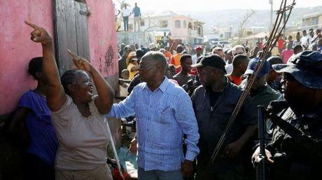 Haiti roi vao khung hoang luong thuc tram trong - Anh 1