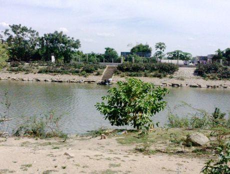 Phat hien thi the noi lenh benh tren song Ha Thanh - Anh 1