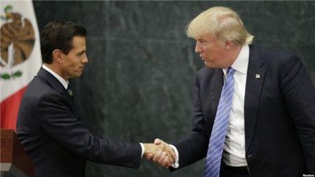 Donald Trump: Toi khong chong lai nhap cu - Anh 1